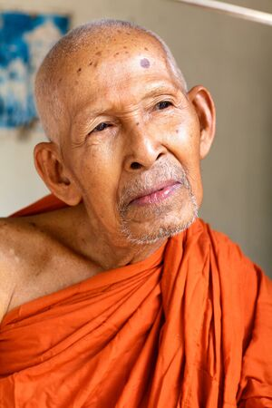 Siem Reap, Cambodia - April 1, 2011: Unidentified Buddhist monk in Siem Reap on April 1, 2011.  Редакционное