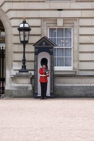 London - June 21, 2009: Sentry of the Grenadier Guards posted outside of Buckingham Palace on June 21, 2009 in London, United Kingdom. The Grenadier Guards traces its lineage back to the year 1656.