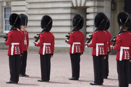 London - June 21, 2009: Changing of the Grenadier Guards outside of Buckingham Palace on June 21, 2009 in London, United Kingdom. The Grenadier Guards traces its lineage back to the year 1656.