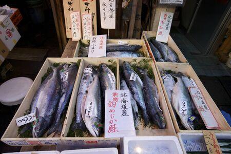 TOKYO- NOVEMBER 20: Seafood buyers at the Tsukiji Wholesale Seafood and Fish Market in Tokyo Japan on November 20, 2009. Tsukiji Market handles over 2000 metric tons of seafood per day.