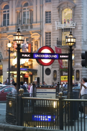 london cityscape: London, June 28, 2009: Piccadilly Circus street at night with underground tube station on June 28, 2009 in London, England. London
