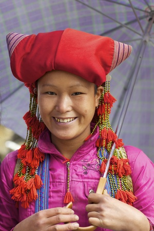 sapa: Sapa, Vietnam - November 22, 2010: Unidentified girl of the Red Dao Ethnic group November 22, 2010 in Sapa, Vietnam. Red Dao is the 9th largest ethnic group in Vietnam with just under 500,000 people.  Editorial