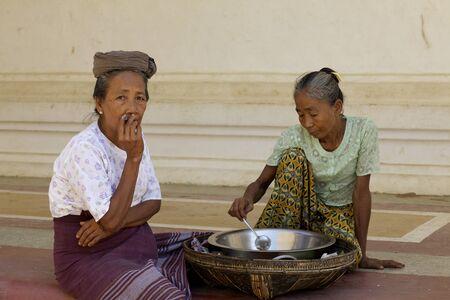 cheroot: Bagan, Myanmar - Oct 15: Unidentified women smoking cheroot and preparing soup in Bagan, Myanmar on October 15, 2011. Editorial
