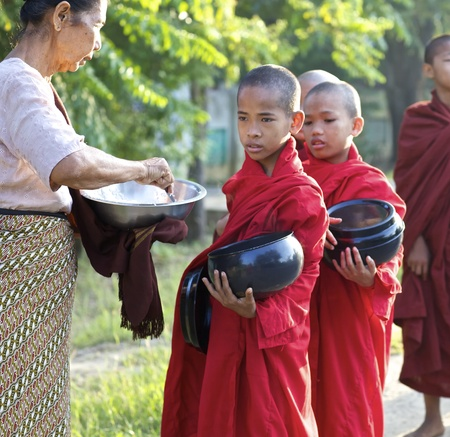 Bagan, Myanmar - Oct 14: Young novice monks walking for morning alms in Bagan, Myanmar on October 14, 2011.