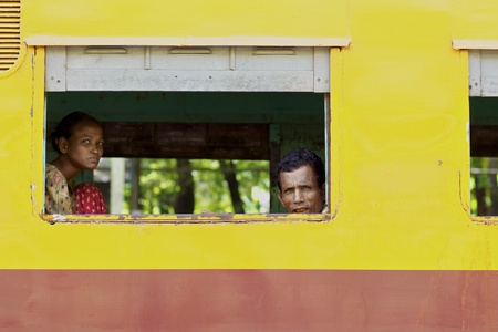 Yangon, Myanmar - October 16, 2011: Passengers aboard a train in Yangon, Myanmar on October 16, 2011.