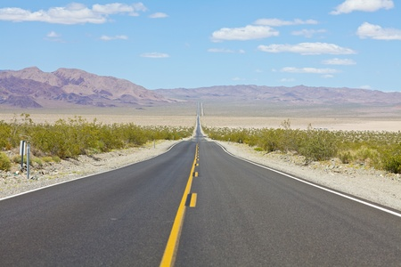 Desolate highway into Death Valley National Park photo