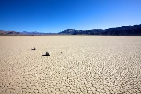 Sliding Rocks on Racetrack Floor in Death Valley National Park, California  Stock Photo