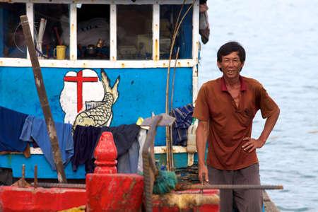 con dao: CON DAO ISLAND, VIETNAM - JUNE 26: Unidentified Vietnamese Man on fishing boat June 26, 2010 at Con Dao Island, Vietnam.