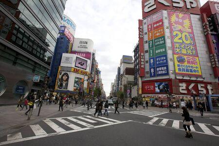 Tokyo - November 17, 2009: Crosswalk on the Shinjuku Street in Tokyo, Japan on November 17, 2009.