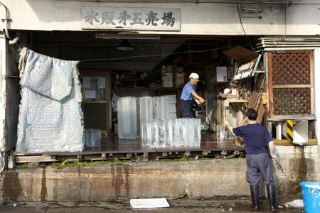 TOKYO- JULY 4: Ice block vendor at Tsukiji Wholesale Seafood and Fish Market in Tokyo Japan on July 4, 2011.
