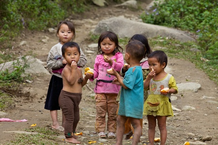 Sapa, Vietnam - November 21: Six unidentified Vietnamese children play and eat in Sapa, Vietnam on November 21, 2010. Vietnam