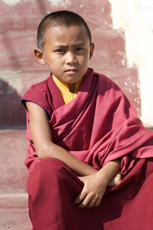 POKHARA, NEPAL - OCTOBER 10: Unidentified Nepalese boy who is learning to become a novice Monk on October 10, 2008 in Pokhara, Nepal.