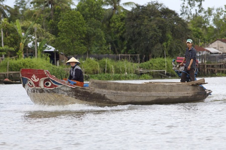 can tho: CAN THO, VIETNAM- MAY 28: A Vietnamese couple travel by boat in Mekong Delta in Can Tho, Vietnam on May 28, 2011. Mekong delta region encompasses a large portion of southeastern Vietnam of 39,000 km2  Editorial