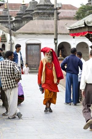 KATHMANDU-OCT 7: A Sadhu walking at Pashupatinath Temple in Kathmandu, Nepal on October 7, 2008. The two primary sectarian divisions in sadhu community are Shaiva sadhus and Vaishnava sadhus.