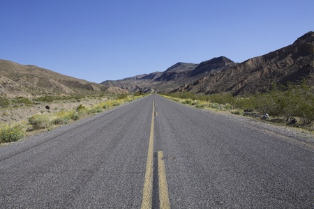 Open Desolate Highway in Desert Mountains photo