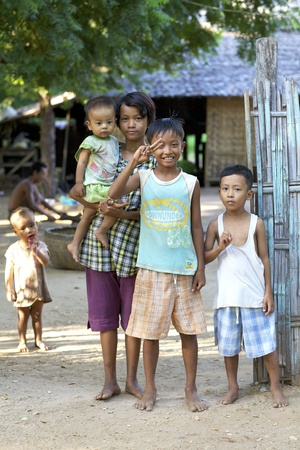 Bagan, Myanmar - October 15, 2011: Unidentified children standing in front of their family home in Bagan, Myanmar on October 15, 2011 Stock Photo - 11654205