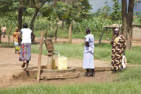 ugandan: Lira, Uganda - June 9: Unidentified villagers pumping water from a well in Lira, Uganda on June 9, 2007