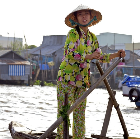 can tho: Can Tho, Vietnam - Jan 7: Unidentified Vietnamese woman selling produce from boat at the famous Can Tho Floating Market in Can Tho, Vietnam on January 7, 2012