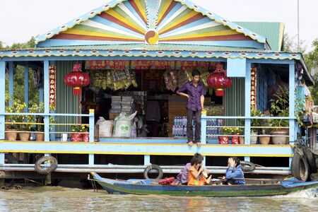 KAMPONG PHLUK, CAMBODIA-JAN 23: A floating market on Tonle Sap Lake in Kampong Phluk, Cambodia on January 23, 2012
