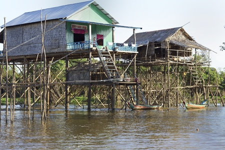 Tonle Sap Lake, Cambodia - Jan 21: Typical Cambodian houses built on stilts above water level in Tonle Sap Lake, Cambodia on January 21, 2012