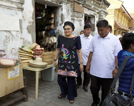 ferdinand: VICAN CITY, PHILIPPINES - FEB 19: Former Philippines First Lady Imelda Marcos shopping amongst supporters in Vican City, Philippines on February 19, 2012. She is widow of President Ferdinand Marcos