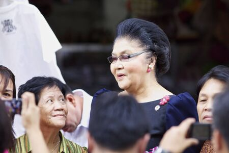 marcos: VICAN CITY, PHILIPPINES - FEB 19: Former Philippines First Lady Imelda Marcos shopping amongst supporters in Vican City, Philippines on February 19, 2012. She is widow of President Ferdinand Marcos