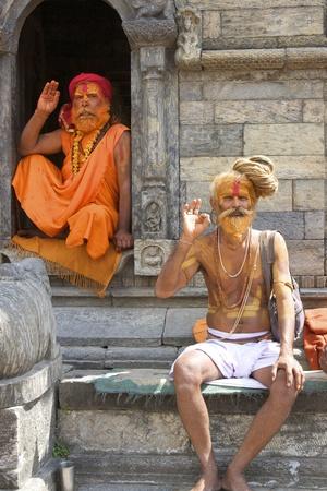 KATHMANDU, NEPAL - CIRCA 2008: Sadhu Holy men relax at Pashupatinath Temple circa 2008 in Kathmandu, Nepal.