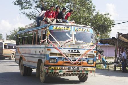 overcrowded: Kathmandu, Nepal - Circa 2008: Overcrowded bus with passengers riding on roof in Kathmandu, Nepal (Circa 2008)