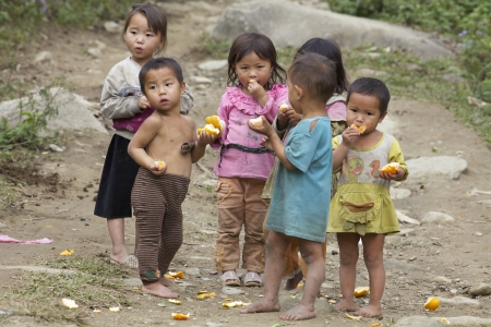 SAPA, VIETNAM- NOVEMBER 21: Six unidentified Vietnamese children play and eat in Sapa, Vietnam on November 21, 2010