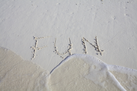 Fun written into beach sand photo