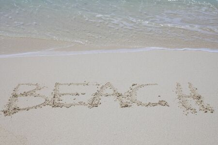Beach written into sand photo