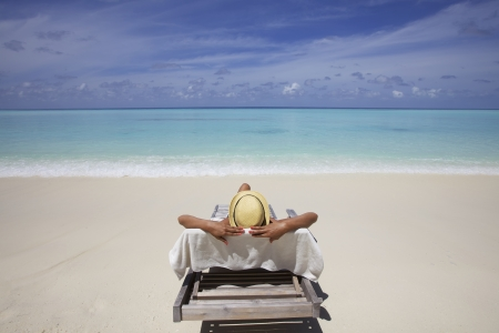 recliner: Girl in lounge chair on Maldives Beach Stock Photo