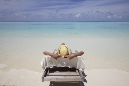 the chaise lounge: Sunbathing on Maldives sand beach