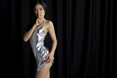 Asian girl showing quiet sign photo