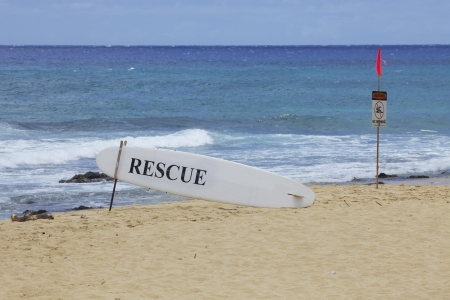 Rescue and Swimming Warning Signs Hawaii Beach Stock Photo