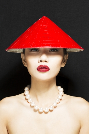 conical hat: Beautiful Asian Girt in red conical hat