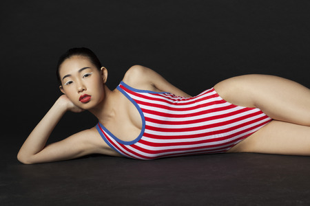 Asian girl in striped swimsuit photo