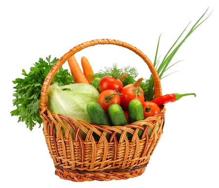 Basket with vegetables, isolated on white photo