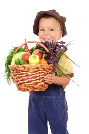 farmers' market: Little boy with basket of vegetables, isolated on white