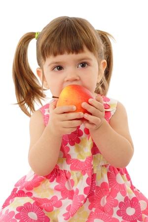 Little girl eating apple, isolated on white Stock Photo - 9144817