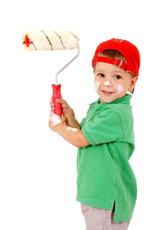 Little worker with paintroller on white wall photo