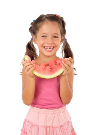 little girl eating: Little girl eating watermelon, studio shoot