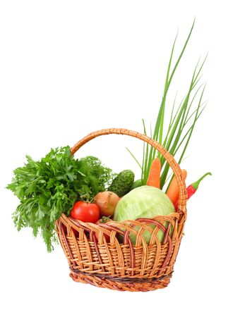 Wicker with vegetables, isolated on white photo