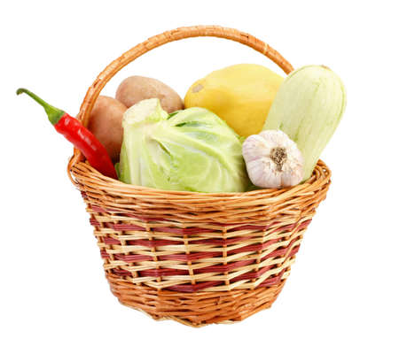 Little basket with vegetables, isolated on white photo