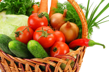 Basket with vegetables, close-up, isolated on white photo