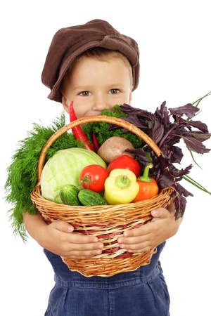 Little boy with basket of vegetables, isolated on white photo