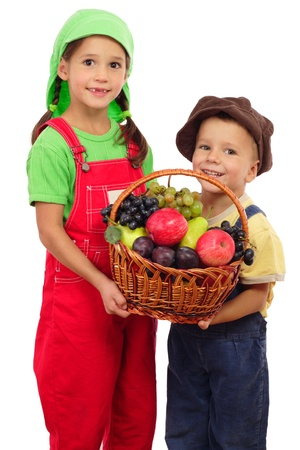 Two little children with basket of fruits, isolated on white photo