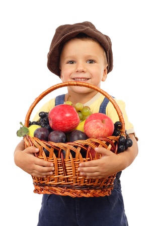 Little boy with basket of fruits, isolated on white photo