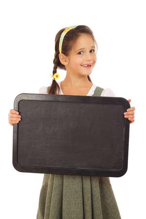 Little schoolgirl with empty chalkboard, isolated on white photo