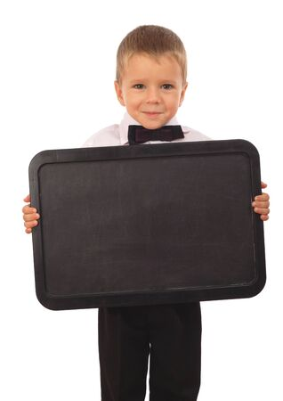 Little boy with empty chalkboard, isolated on white photo
